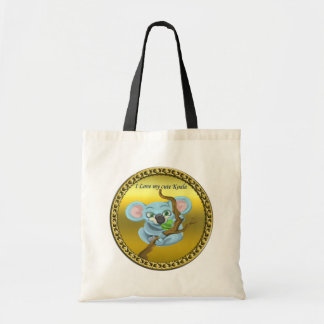 Adorable koala bear in a tree in the forest tote bag