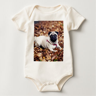 Adorable Pug Rests On The Autumn Foliage Baby Bodysuit