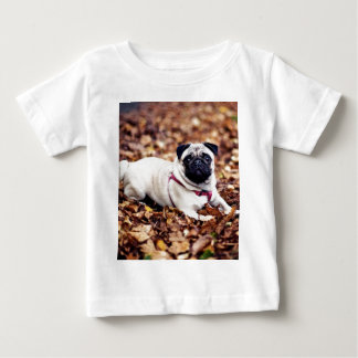 Adorable Pug Rests On The Autumn Foliage Baby T-Shirt