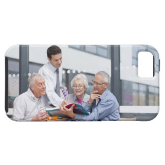 Adult students and teacher studying together in 2 iPhone 5 covers