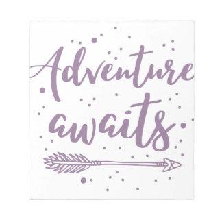 adventure awaits  in purple notepad