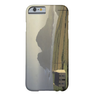 aerial view of a cottage on a hill by the sea iPhone 6 case
