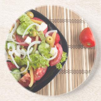 Aerial view of one portion of vegetable salad beverage coasters