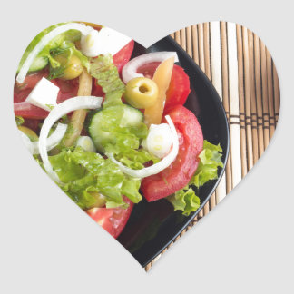 Aerial view of one portion of vegetable salad heart sticker