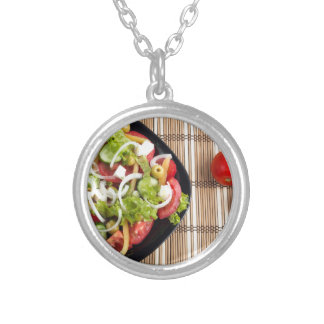 Aerial view of one portion of vegetable salad silver plated necklace