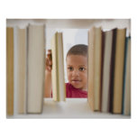 African American boy selecting book Poster