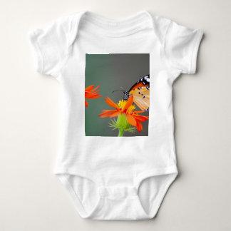 African Monarch butterfly on orange flower Baby Bodysuit