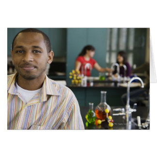 African teacher in chemistry lab greeting card