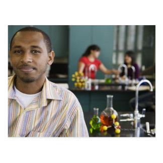 African teacher in chemistry lab postcard