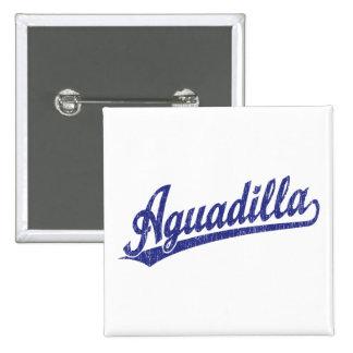 Aguadilla script logo in blue buttons