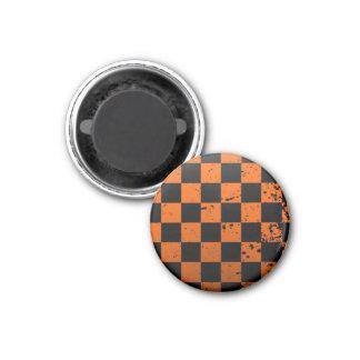 Aimant rond de damier noir et orange