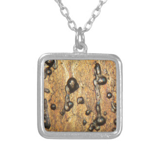 Air bubbles in ice under the microscope silver plated necklace