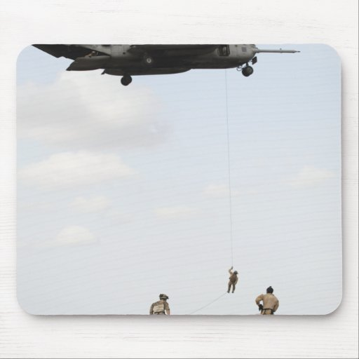 Air Force pararescuemen conduct a combat insert Mouse Pads