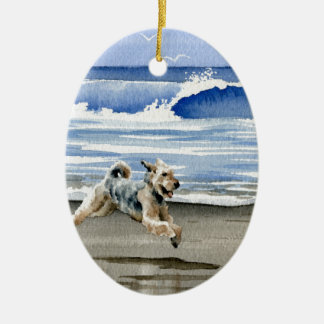 Airedale Terrier At The Beach Ceramic Oval Ornament