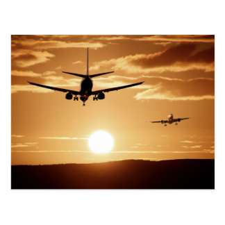 Airplane and sunset postcard