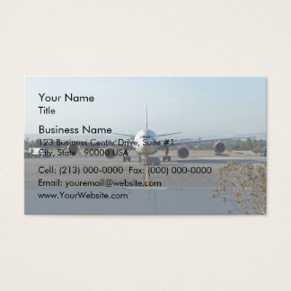 Airplane at airport with blue sky in background business card