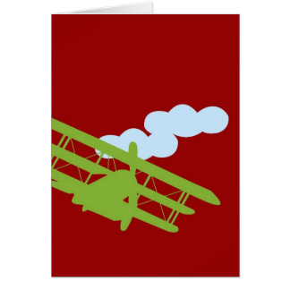 Airplane on plain red background. card