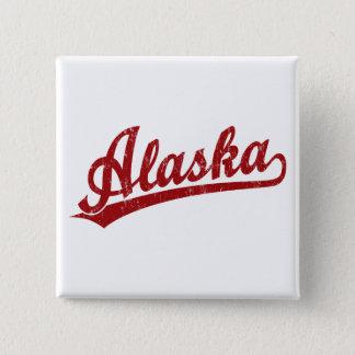 Alaska script logo in red 2 inch square button