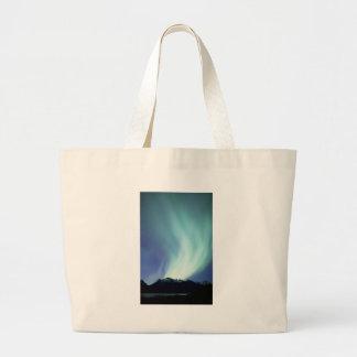 Alaskan aurora borealis lights in the night sky large tote bag