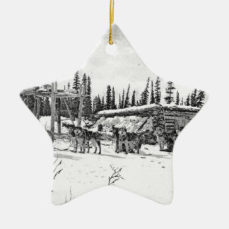 Alaskan Sled Dogs Standing Outside a Log Cabin Ceramic Ornament