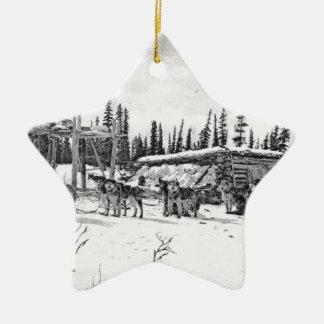 Alaskan Sled Dogs Standing Outside a Log Cabin Ceramic Star Ornament