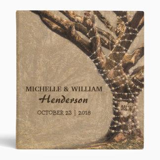 Album rustique de mariage d'arbre avec des classeur