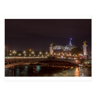 Alexander bridge and large palace At night Paris Postcard