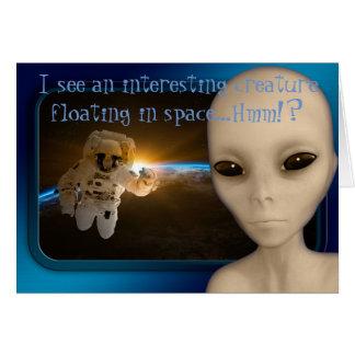 ALIEN CARD, ALIEN SEES AN ASTRONAUT IN SPACE CARD