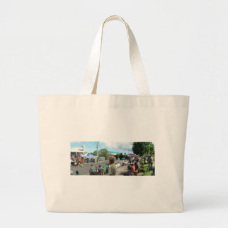alien in the crowd large tote bag