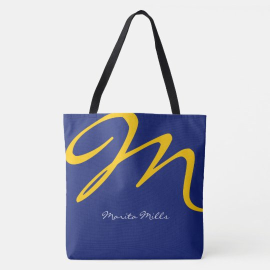 all-over-print blue tote bag with yellow initial