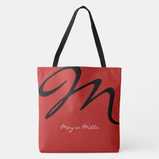 all-over-print red tote bag with black initial
