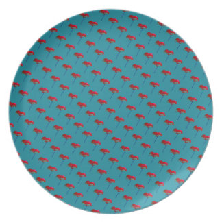 All-over red poppy pattern on teal blue plate