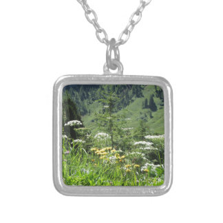 Alpine landscape with wildflowers and firs silver plated necklace