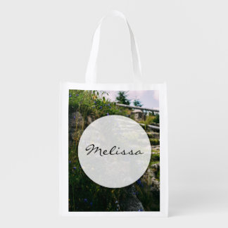 Alpine Wild Flowers On A Hiking Road Grocery Bag