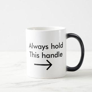 Always hold this handle magic mug