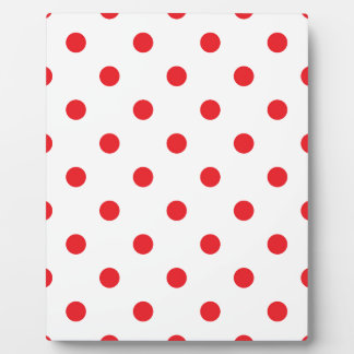 Amazing red dots on white plaque
