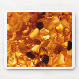 Amber grains with backlight illumination mouse pad