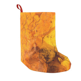 Amber stone texture background small christmas stocking