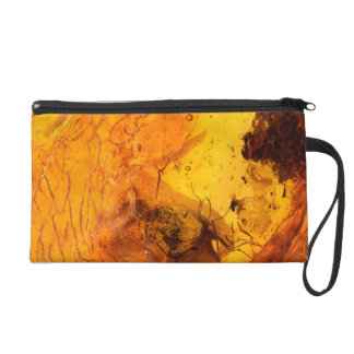 Amber stone texture background wristlet purses