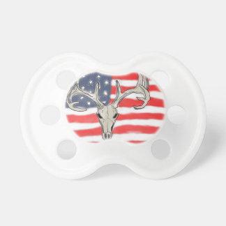 American flag behind a deer skull pacifier