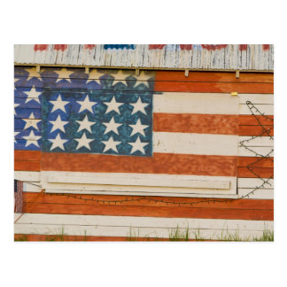 American flag painted onto fireworks stand near postcard