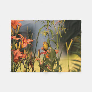American goldfinch in the garden with day lilies fleece blanket
