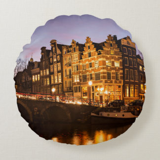 Amsterdam canal houses at dusk round pillow