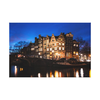 Amsterdam canal houses at night canvas print