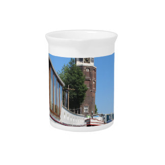 Amsterdam canal view - Boats and spire Beverage Pitcher