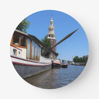 Amsterdam canal view - Boats and spire Clocks