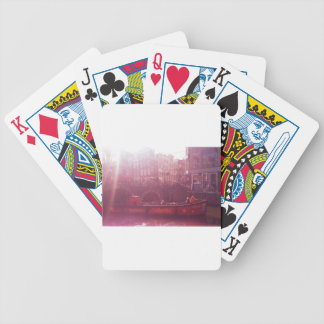 amsterdam canal view with cruise boat bicycle playing cards