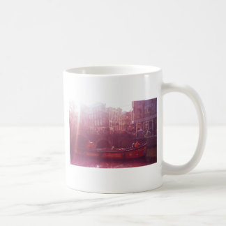amsterdam canal view with cruise boat coffee mug
