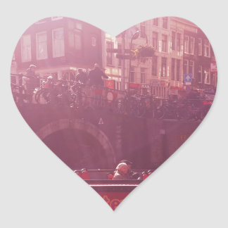 amsterdam canal view with cruise boat heart sticker