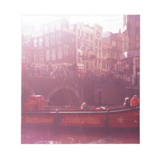 amsterdam canal view with cruise boat notepad